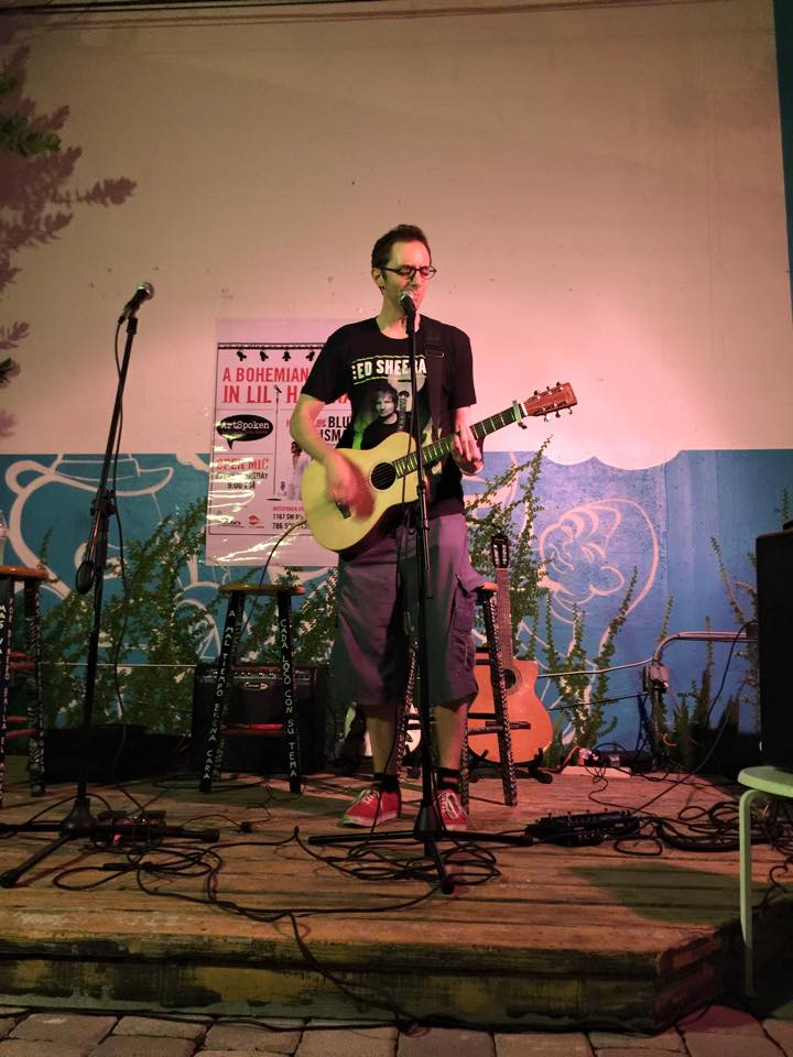 Brian LeBlanc playing at Blue Talisman open mic in his Ed Sheeran tour shirt